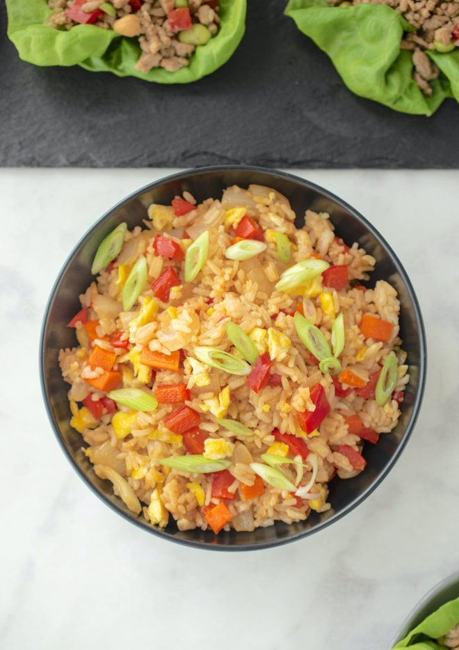 A bowl of colorful vegetable fried rice from above