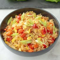 Vegetable fried rice in a black bowl