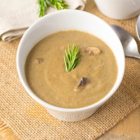Vegan mushroom soup. A healthy and flavorful soup minus the cream. Fresh mushrooms, leeks, garlic and rosemary cooked in mushroom broth and blended with cashews.