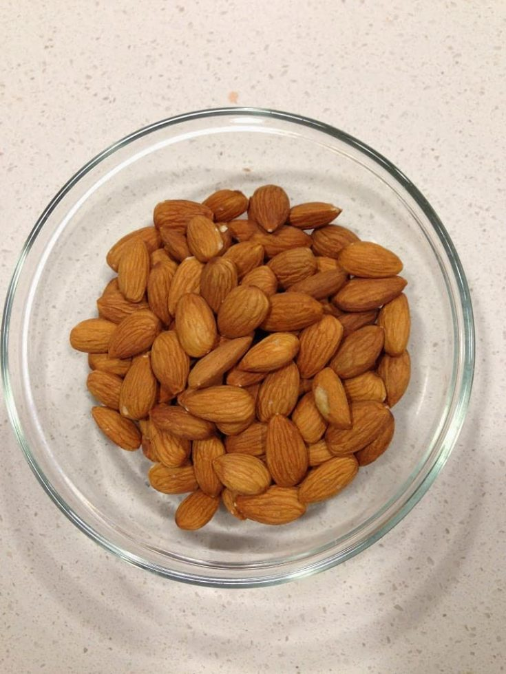 A glass bowl of almonds