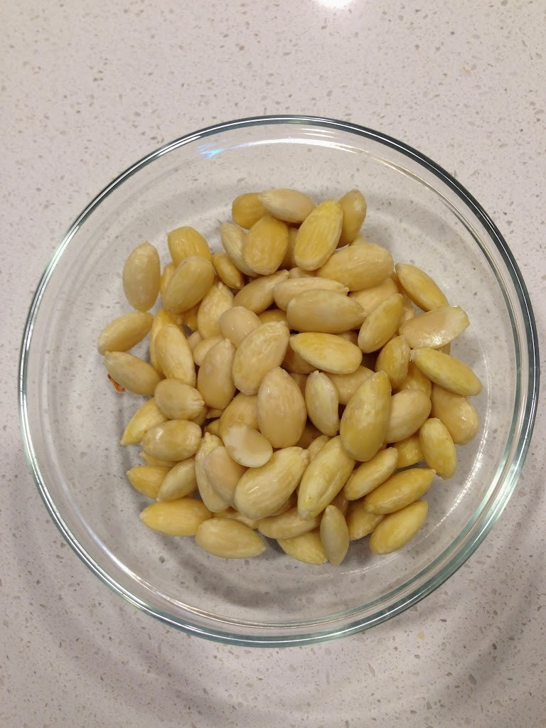 A bowl full of peeled almonds