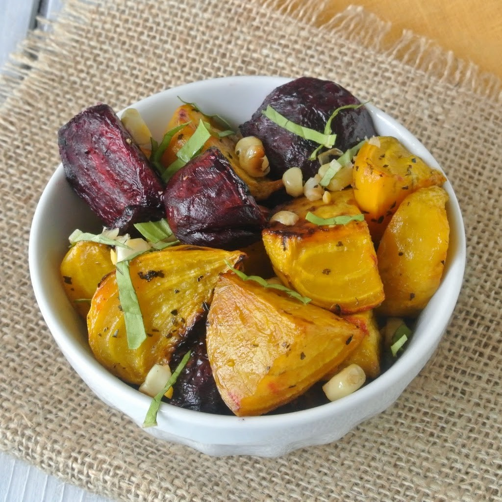 Red and gold roasted beets with grilled corn in a white bowl