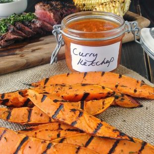 Grilled sweet potatoes with a jar of curry ketchup