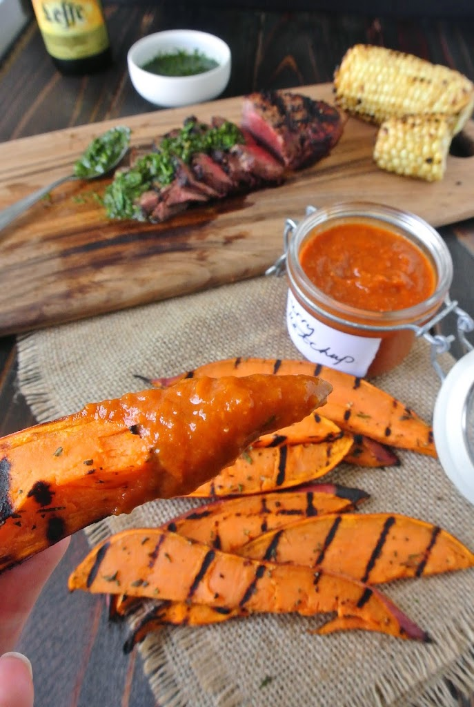 Grilled sweet potato wedges with curry ketchup. Sweet, herby, and smokey, these grilled sweet potato wedges get an added spice kick when dipped in curry ketchup.