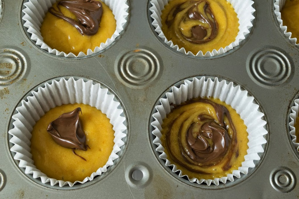 Muffin batter is swirled with nutella