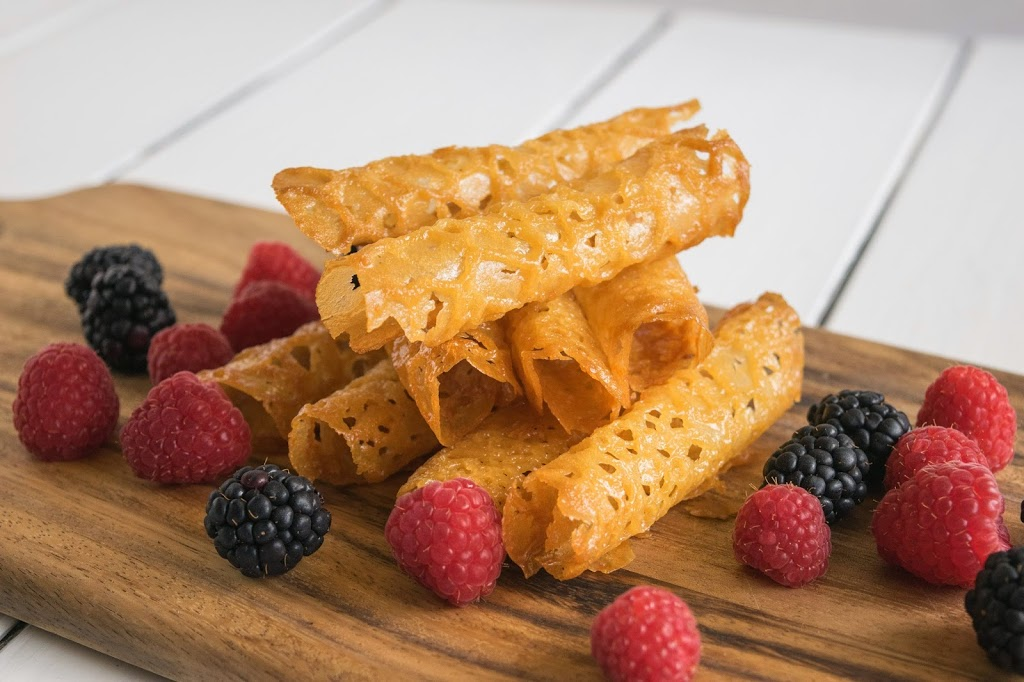 Brandy snaps are a popular dessert in the UK. Crispy golden lacy tubes filled with brandy whipped cream. A British holiday tradition and the brandy is optional.