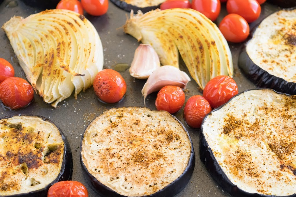 Roasted eggplant slices, onions, tomatoes and cherry tomatoes