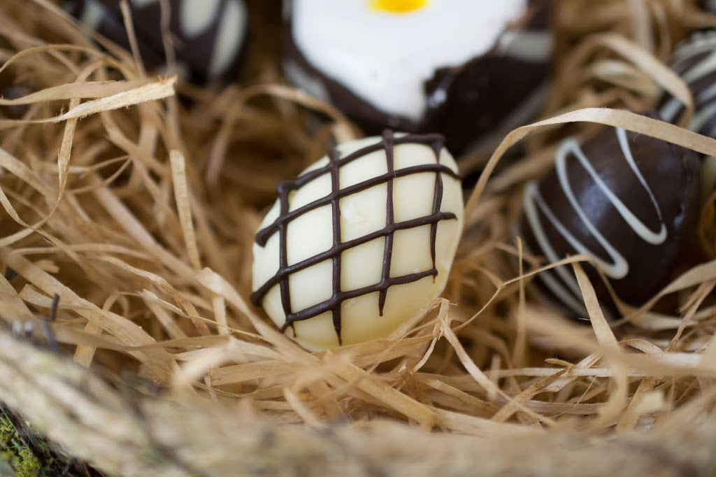 A white chocolate egg with a diamond pattern of dark chocolate