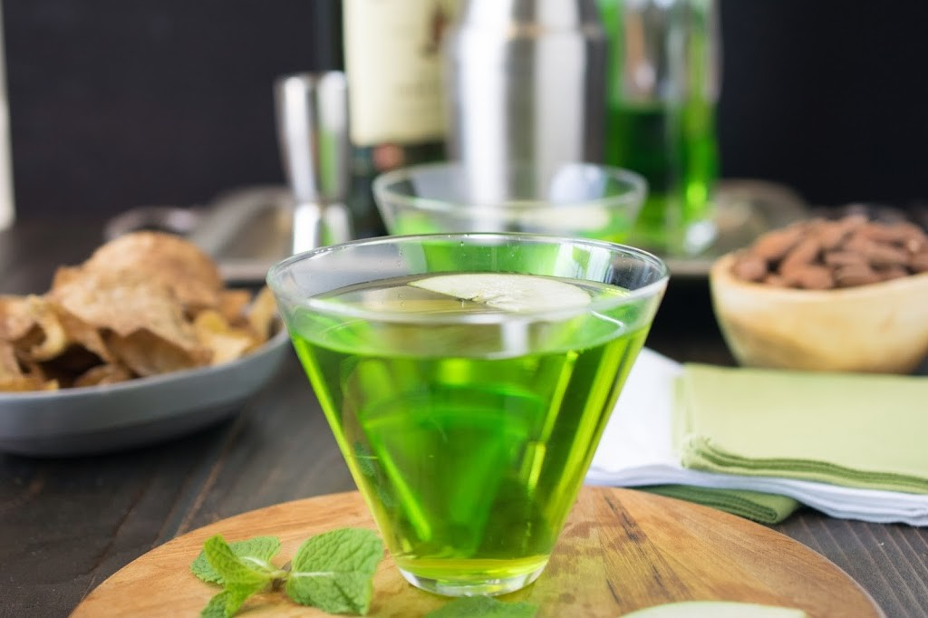 A side view of the cocktail showing the vibrant green color