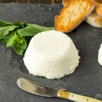 Ricotta with a knife, fresh mint and bread