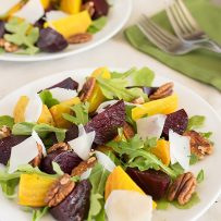 Red and gold roasted beets in a salad with pecans and shaved Parmesan cheese