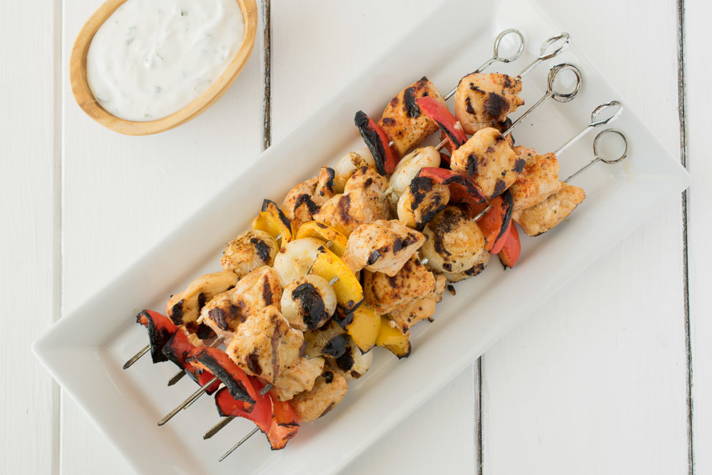 Shish kebab are skewers of seasoned chicken and vegetables that are grilled. They come with a delicious lime and mint dipping sauce for a healthy and quick grilled summer meal.