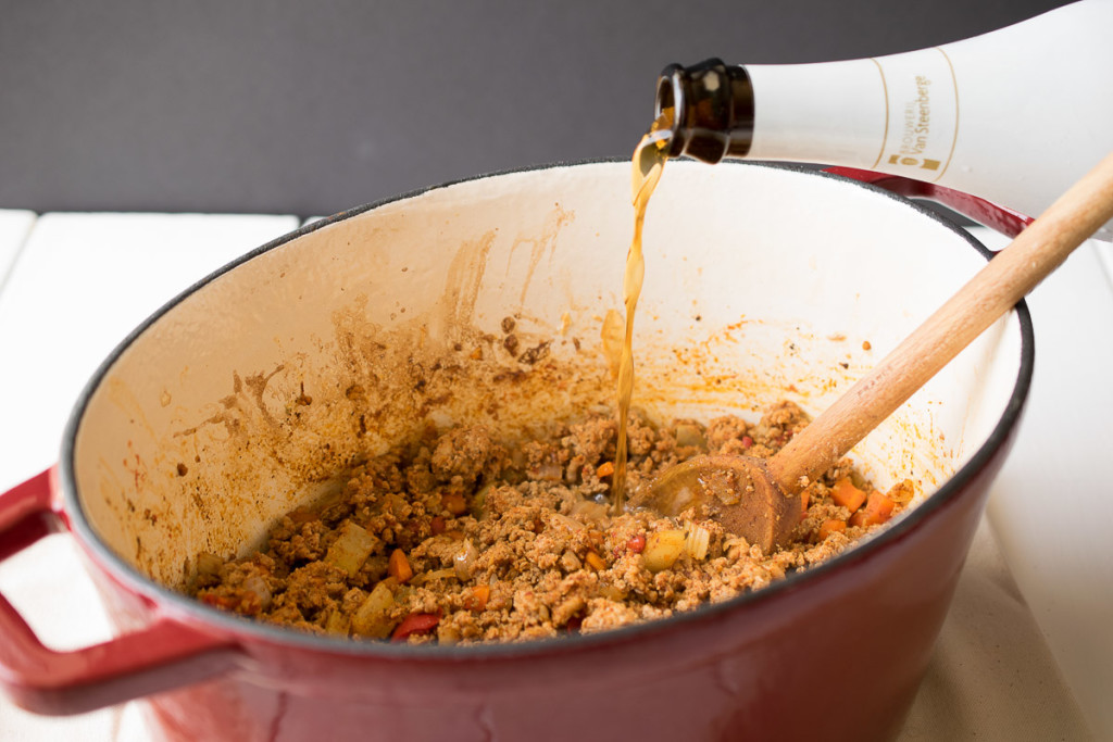 Belgian beer being added to turkey chili