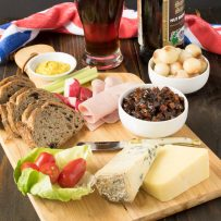 A very British and extremely popular pub lunch item, the Ploughman's lunch is a meal consisting of cold meats, cheese, bread, pickle and of course, beer. It's like a picnic on plate. This recipe, the fabled Ploughman's lunch, completes my British recipes week.