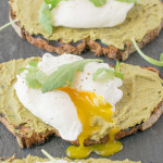 4 Avocado artichoke toast with poached eggs on a slate board