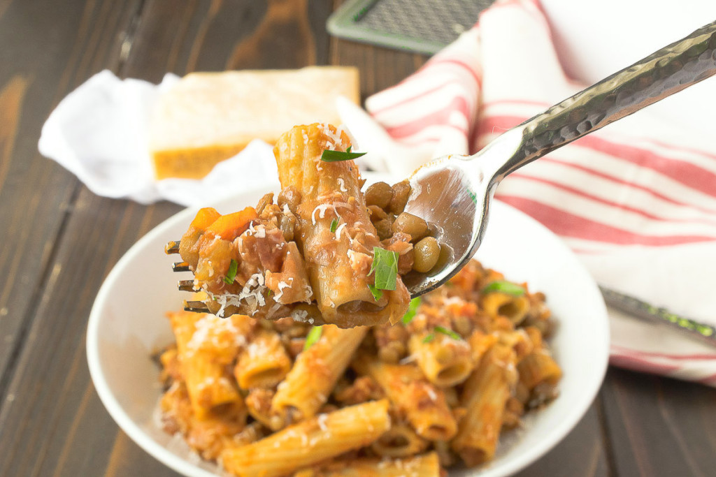 A fork full of pasta and lentils