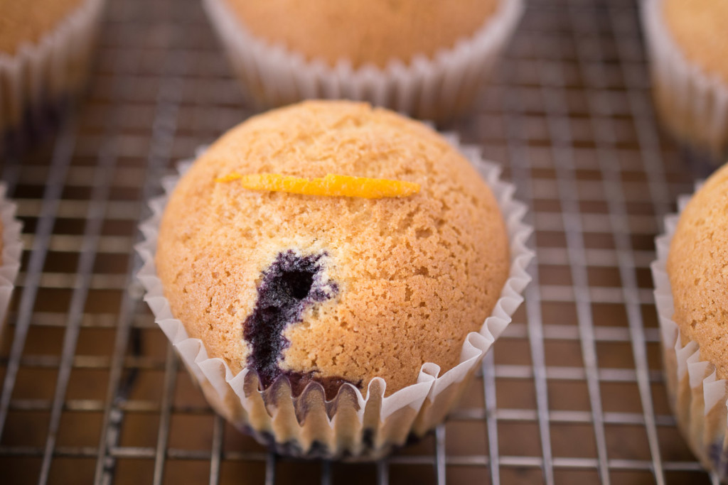Blueberry orange upside down muffin on a cooling rack