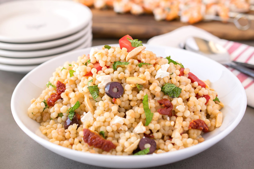 Mediterranean couscous salad in a white bowl