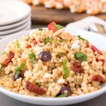 The perfect barbecue side dish. Mediterranean couscous salad is a quick and easy side dish that is so versatile it can be eaten warm, room temperature or even cold. It can also be turned into a main dish by adding grilled chicken, fish or beef.