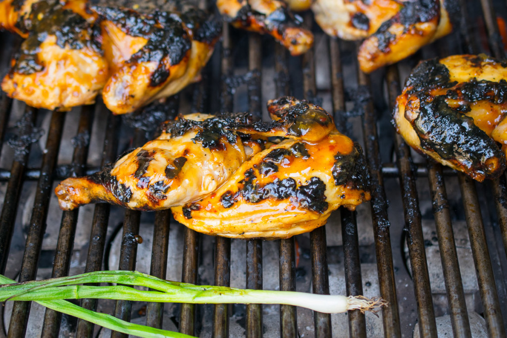 Asian grilled Cornish hens are deliciously saucy. Cornish hens are cut in half, marinated in Asian flavors then grilled to crispy perfection. Pass the wet wipes... it's about to get messy all up in here!