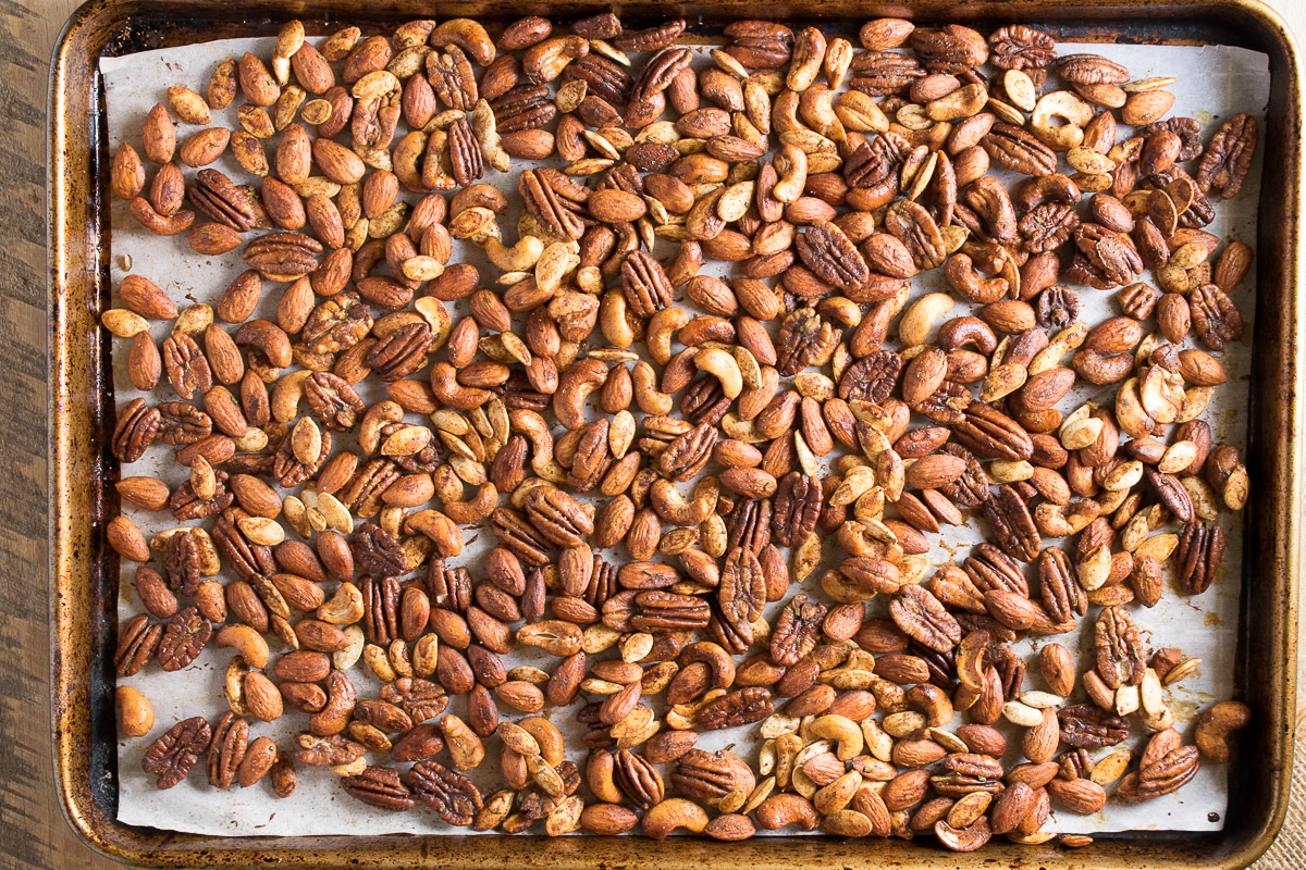 A baking sheet full of roasted nuts fresh out of the oven