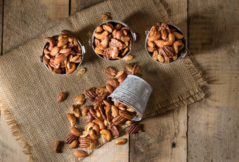 4 buckets of nuts with 1 spilled