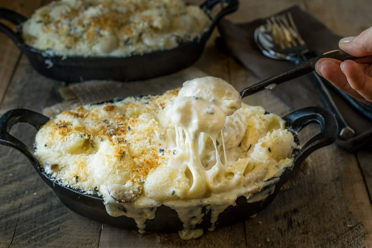 Mushroom, sage mac and cheese - Creamy, really creamy and gooey cheese sauce with a meaty bite from mushrooms, earthy flavor from fresh sage (for an essence of Fall) and a crunchy panko breadcrumb topping. It's comfort food taken to the next level.