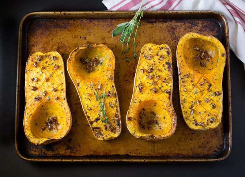Roasted butternut squash lined up on a baking sheet