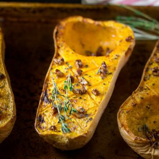 All the flavors of fall come together in one easy side dish. Roasted butternut squash with maple pecans is a side dish that is perfect for family or holiday dinners.
