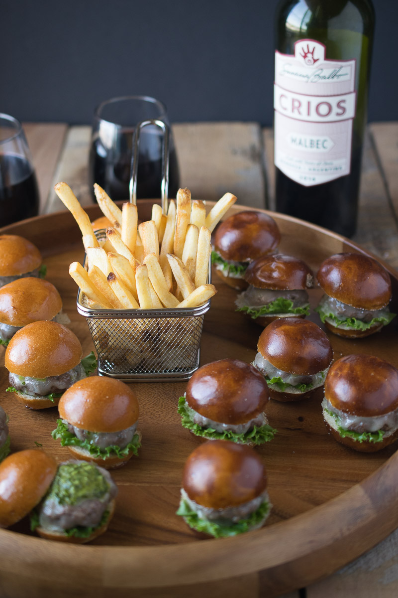 Chimichurri sauce is in and on the burgers which are topped with melted provolone cheese and served on mini brioche and pretzel buns, the perfect 2-biters