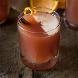 This sparkling apple punch is a refreshing mix of apple cider, cranberry juice and orange juice with a little fizz from sparkling seltzer water for an effervescent and bubbly way to quench a hearty thirst.