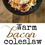 Warm bacon coleslaw in a black bowl and a bite on a fork