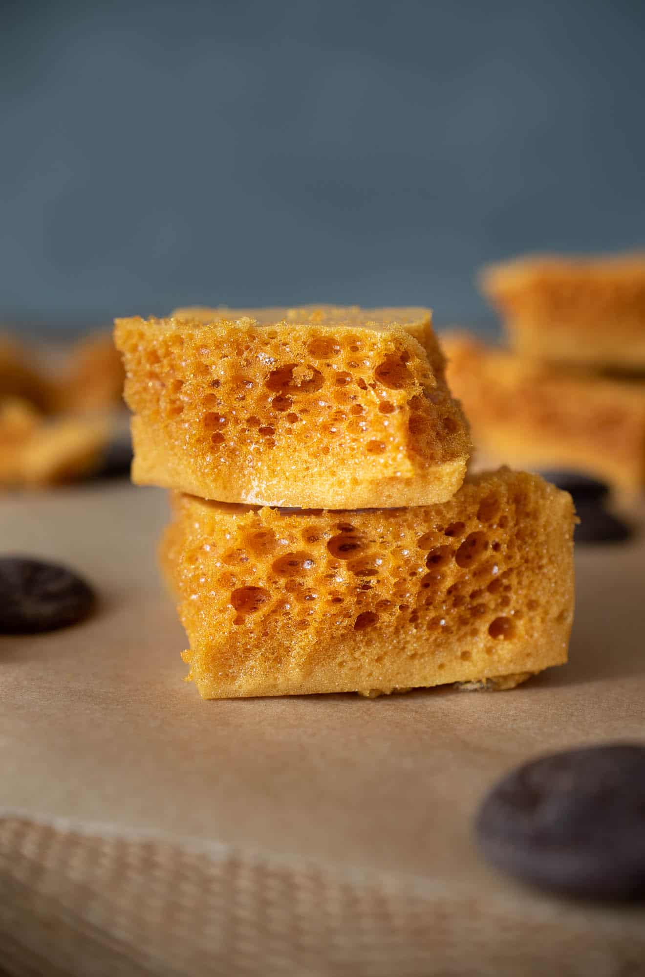 Cut pieces of 3 Ingredient Cinder Honeycomb Toffee showing the crispy holes