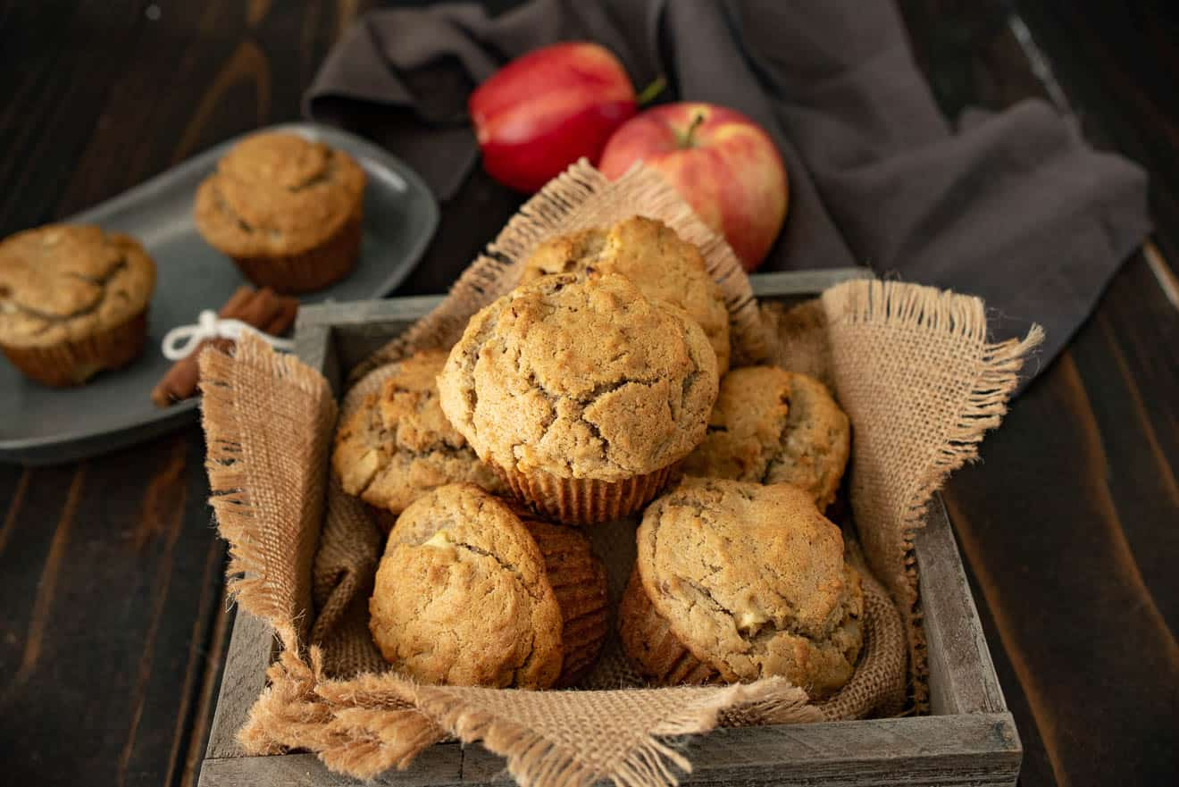 Apple pie pecan muffins in a burlap lined wood bowl