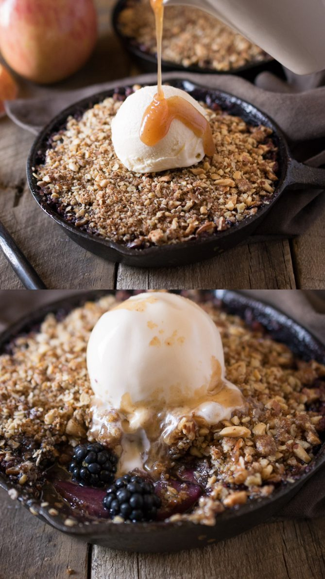 Drizzling caramel over vanilla ice cream that is on top of apple and blackberry crumble