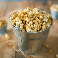 A silver bucket of of apple cider caramel popcorn