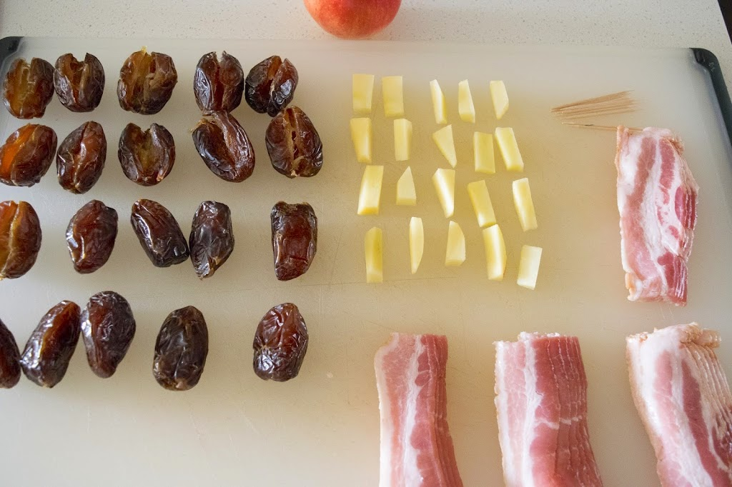 Dates, apple pieces and bacon slices ready to build
