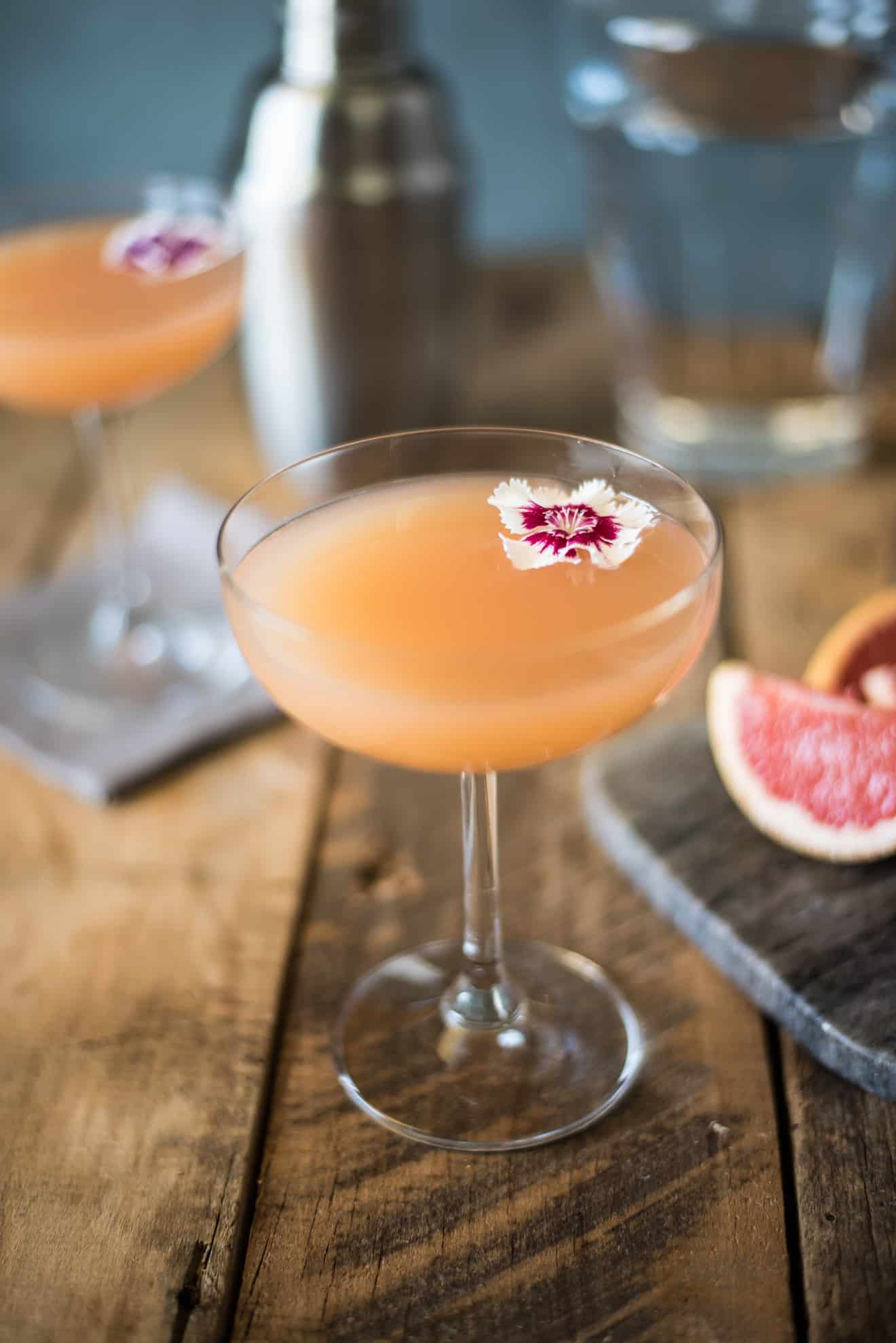 Beautiful pink grapefruit drink in a stemmed glass