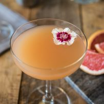 The drink from overhead showing the pretty red and white flower garnish