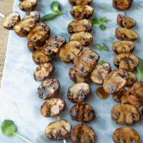 Grilled mushrooms coated in a delicious soy marinade.