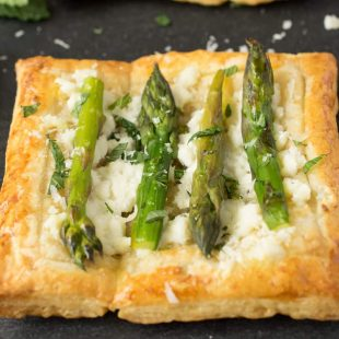 A square puff pastry tartlet topped with ricotta, mint and asparagus