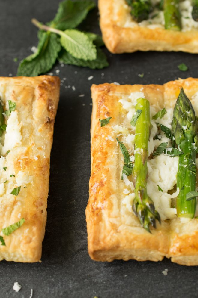 Perfectly brown and crispy puff pastry made into tartlets and topped with asparagus, ricotta and mint