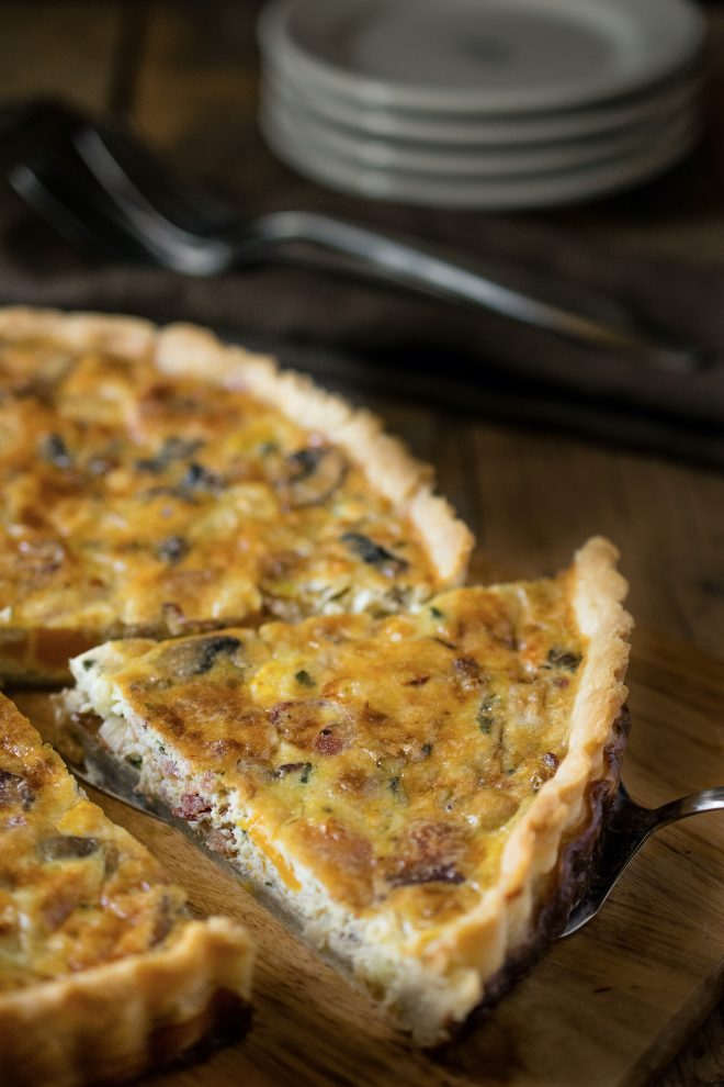 Serving a slice of Autumn Harvest Quiche