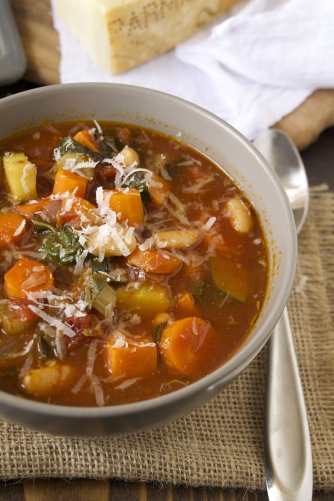 A closeup showing the carrots, squash and beans in the soup