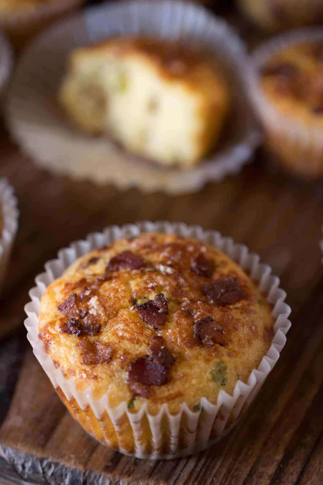 A closeup showing the bacon topping on the muffin