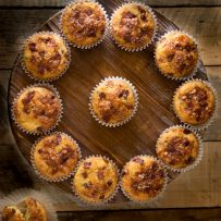 Bacon cheddar corn muffins displayed in a circle from overhead