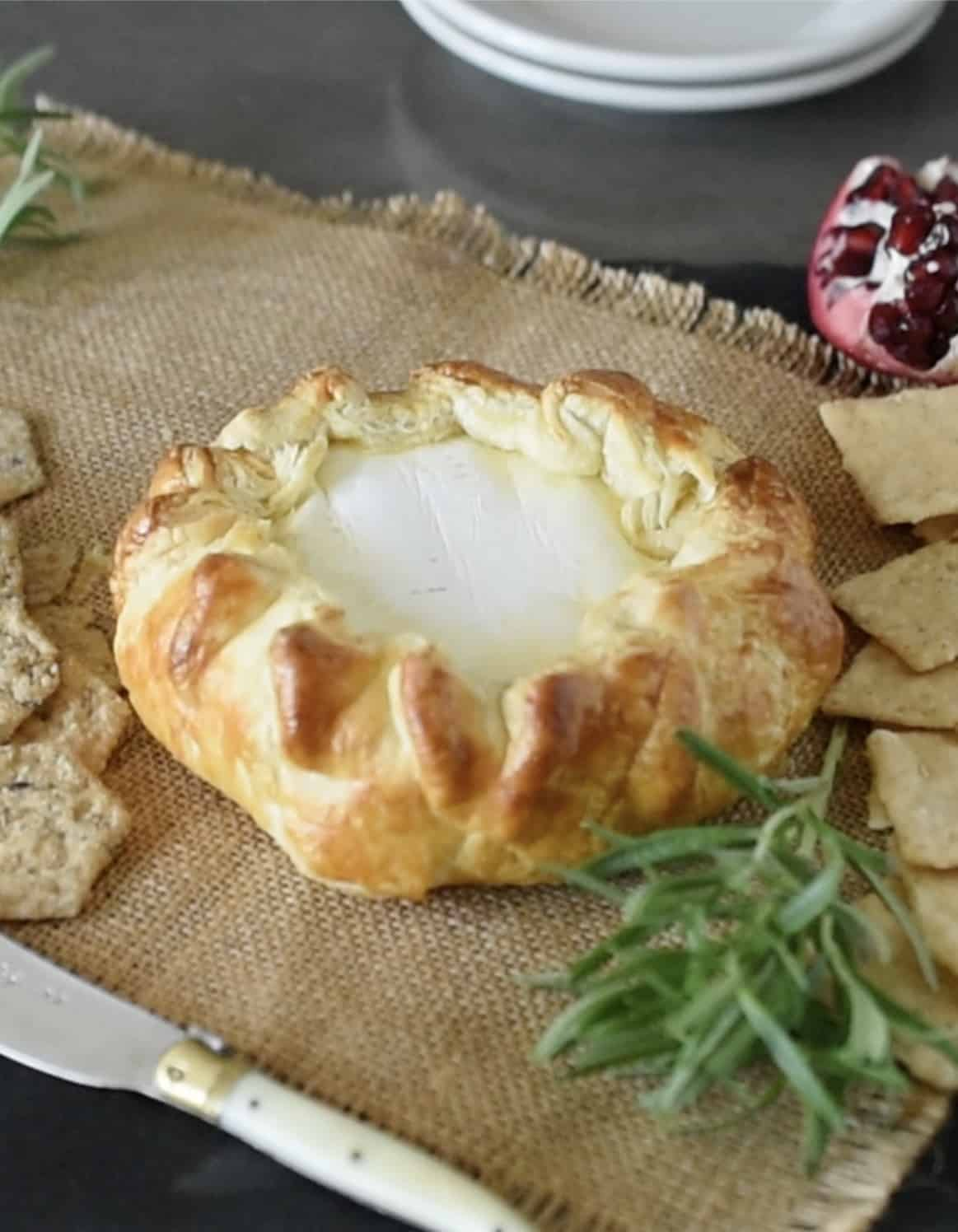 A wheel of brie wrapped in puff pastry and baked