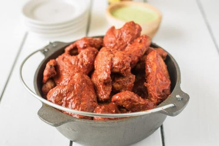 Baked adobo chicken wings bring a Mexican twist to a favorite finger food. Wings are baked to crispy perfection then bathed in a delicious adobo sauce made with dried peppers and spices. Grab the napkins...