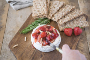 Baked brie with strawberries and rosemary is an easy and impressive dish to serve when entertaining. Creamy brie pairs perfectly with sweet strawberries and fresh rosemary served on top of a delicious, crunchy multigrain crispbread. What is better than warm melted cheese?