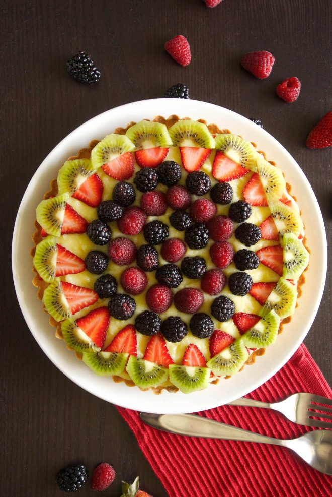 The tart viewed from overhead with berries around